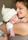 Madre con il suo bambino fotografie stock