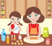 Madre con la pasta del cuoco della figlia Fotografie Stock
