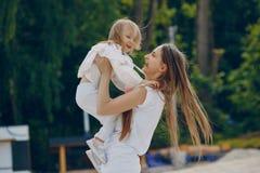 Madre con le figlie Fotografia Stock