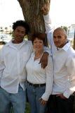 Madre con los niños adoptados Fotos de archivo