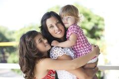 Madre con sus hijas hermosas Imagen de archivo