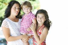 Madre con sus hijas hermosas Imagenes de archivo