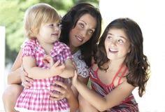 Madre con sus hijas hermosas Foto de archivo libre de regalías
