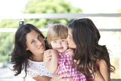 Madre con sus hijas hermosas Fotografía de archivo