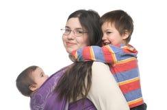 Madre con sus niños Imagen de archivo libre de regalías