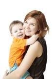 Madre con un niño en un fondo blanco Fotos de archivo libres de regalías