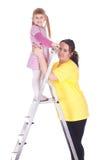 Madre e bambina grasse con la scaletta Fotografia Stock Libera da Diritti