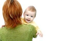 Madre e bambino su bianco Immagini Stock