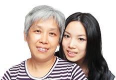 Madre e figlia di sorriso Immagini Stock Libere da Diritti