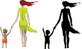 Madre e figlio della siluetta fotografia stock libera da diritti