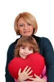 Madre e hija con el corazón Foto de archivo libre de regalías