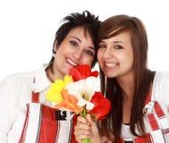 Madre e hija con las flores Fotografía de archivo libre de regalías