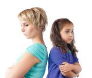Madre e hija tristes de nuevo a la parte posterior imagen de archivo libre de regalías