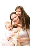 Madre e hijas fotos de archivo
