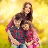 Madre felice con il suoi derivato e figlio Fotografia Stock Libera da Diritti