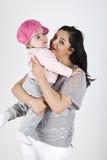 Madre felice con la neonata Fotografie Stock Libere da Diritti