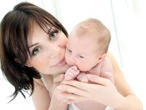 Madre felice con un bambino Fotografia Stock