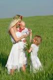 Madre feliz con dos niños Fotografía de archivo libre de regalías