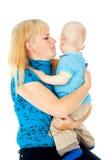 Madre feliz con el bebé fotografía de archivo