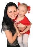 Madre feliz con la pequeña hija Foto de archivo libre de regalías