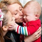 Madre feliz con los niños Foto de archivo libre de regalías