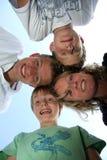 Madre feliz con sus tres hijos Foto de archivo libre de regalías