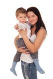 Madre feliz con un niño Imagen de archivo libre de regalías