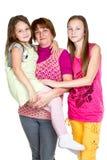 Madre feliz y dos hijas Fotos de archivo libres de regalías