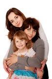 Madre feliz y dos hijas, adolescente y niño. Foto de archivo