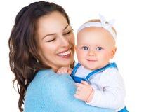 Madre feliz y y pequeña hija Foto de archivo libre de regalías
