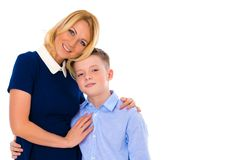 Madre joven hermosa con su hijo adolescente en el estudio Imagenes de archivo