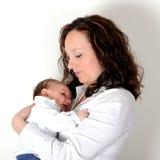 Madre joven y su bebé foto de archivo libre de regalías