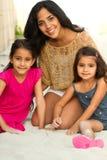 Madre joven y sus dos hijas Imágenes de archivo libres de regalías