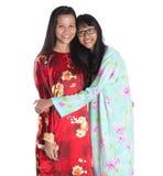 Madre malaya asiática e hija adolescente III Imagenes de archivo