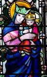 Madre Maria con Jesús en sus brazos Foto de archivo