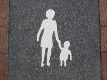 Madre-Niño-icono (espacio de estacionamiento) Imágenes de archivo libres de regalías