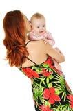 Madre que abraza al bebé sobre blanco Imagen de archivo libre de regalías