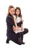 Madre que abraza a su hija Fotos de archivo