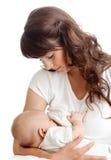 Madre que amamanta a su niño Foto de archivo