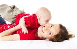 Madre que juega con su bebé Fotografía de archivo