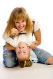 Madre que juega con su hijo Fotografía de archivo