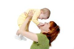 Madre y bebé en blanco Foto de archivo libre de regalías