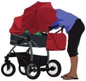 Madre y carro Foto de archivo libre de regalías