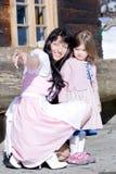 Madre y niño en traje Imágenes de archivo libres de regalías