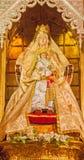 Madri - estátua de Madonna no vestido tradicional da igreja San Isidoro Fotografia de Stock