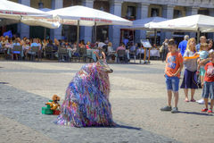 Madrid. Animator dressed as a strange beast. Spain, Madrid - May 02.2014: Artist entertainer in the town square in the Major suit strange animal Stock Image