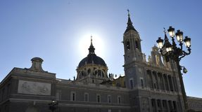 Madrid the cathedral. The cathedral of seniora de la almudena with its spiers and the dome in backlight royalty free stock photography