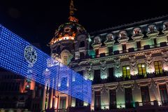 Madrid at Christmas. Night view of the Metropolis building of Ma stock image