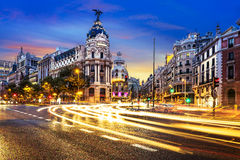 Madrid city center, Gran Vis Spain. Rays of traffic lights on Gran via street, main shopping street in Madrid at night. Spain, Europe Stock Images