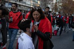 MADRID, DECEMBER 09 - River Plate supporters paint their faces in the final of the Copa Libertadores at the Bernabéu stadium royalty free stock image